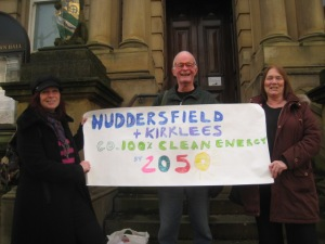 Huddersfield FoE supporters on the steps of Huddersfield Town Hall